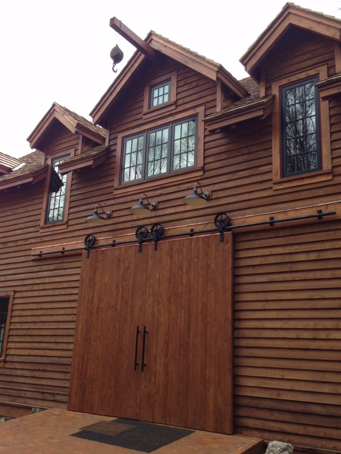 Barn style sliding entry doors architectural woodcraft for Barn style exterior doors